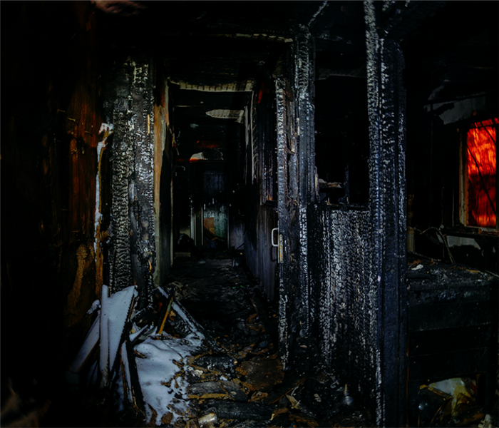 dark and burned wooden house corridor after fire