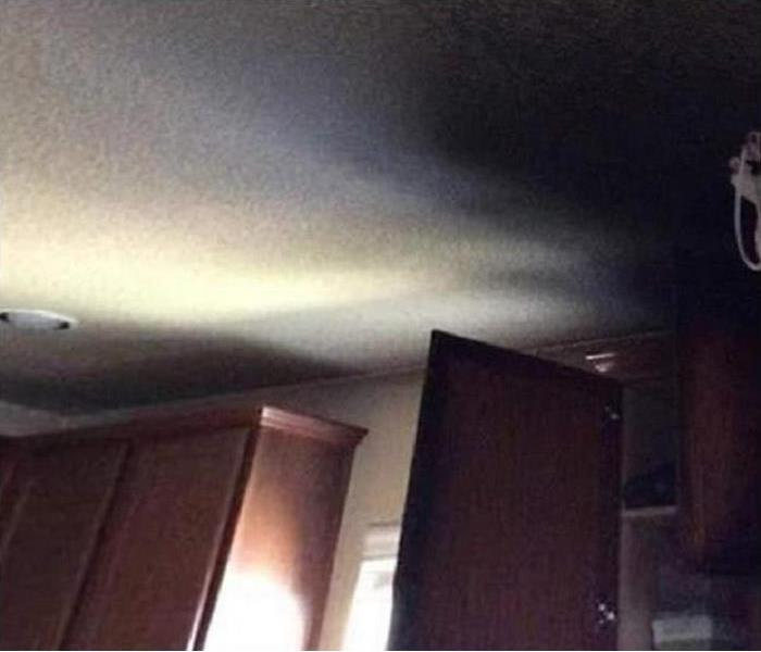 fire damaged cabinet; soot on ceiling