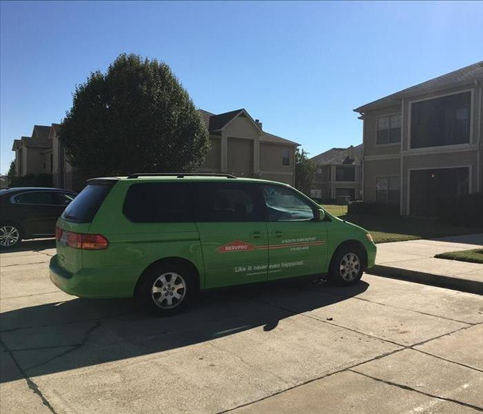 Green SERVPRO Van Parked at Job-Site