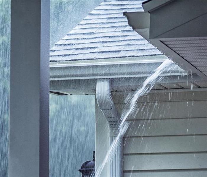 Rain hitting the roof of a home.